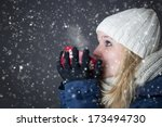 woman warming up with hot drink | Shutterstock . vector #173494730