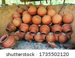 Clay Pots Are Arranged In...