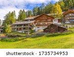 Zermatt, alpine village, Switzerland, Swiss Alps colorful autumn panorama, houses and trees - stock photo