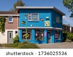 Small photo of Eindhoven, The Netherlands, May 16th 2020. Tante Netty, a creative place with a colorful bright blue facade in a street downtown in Eindhoven. Shot on a sunny day during spring