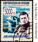 Small photo of Moscow, Russia - May 20, 2020: stamp printed in Guinea shows portrait of Irish Antarctic explorer Ernest Shackleton (1874-1922), and penguin, circa 2008