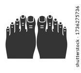 woman s feet black glyph icon....