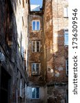 Small photo of Old tenement houses to Praga / Warsaw / Poland. Squalid, seedy buildings of the poor disctrict.