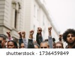Arms Raised In Protest. Group...