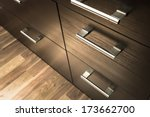 Stock photo a wooden wardrobe drawer front metal handle 173662700