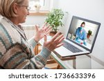 Small photo of Elderly caucasian woman interacting with young female doctor via zoom video call,medical worker seeing patient in virtual house call,telemedicine during pandemic and on demand medical service concept