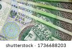 Polish currency banknotes, paper money background. Polish zloty (the masculine from the Polish word 'golden') currency closeup. PLN 100 / 100 zl. Financial growth, home budget, saving money, business. - stock photo