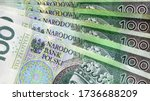 Small photo of Polish currency banknotes, paper money background. Polish zloty (the masculine from the Polish word 'golden') currency closeup. PLN 100 / 100 zl. Financial growth, home budget, saving money, business.