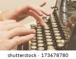 Stock photo hands writing on old typewriter 173678780