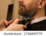 Barber Trimming Beard Of Male...