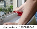 Woman Washes A Window And...