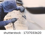 Close up car thief hand holding screwdriver tamper yank and glove black stealing automobile trying door handle to see if vehicle is unlocked  trying to break into inside.  - stock photo
