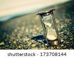 sand timer on pebble beach  ... | Shutterstock . vector #173708144