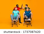 Small photo of Full size photo two men afro american meeting hold hands high five gesture persuade blonde hair pals office chair ride race scared fast speed isolated yellow color background
