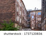 Small photo of Warszawa / Poland - 05.16.2020: Old tenement houses to Praga / Warsaw. Squalid, seedy buildings of the poor disctrict.