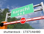 Barrier gate at Karachi road sign, Pakistan. Conceptual coronavirus or some other disease quarantine related 3D rendering