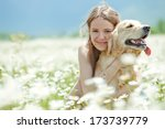 Stock photo woman on nature with a dog 173739779