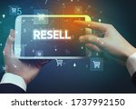 Small photo of Close-up of a hand holding tablet with RESELL inscription, online shopping concept