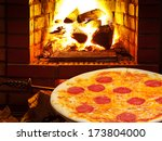 italian pizza with salami and... | Shutterstock . vector #173804000