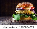 Small photo of vegan burger on rustic wooden table, with vegetable burger and meat flavor. Healthy vegan food.