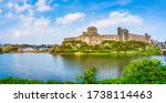 Small photo of Pembrokeshire, Wales, UK: Landscape with the ruins of Pembroke Castle on the shores of river Pembroke, the original family seat of the Earldom of Pembroke