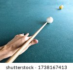 A Man's Hand Striking The Cue...