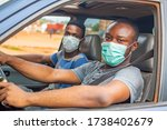 African Driver And Passenger...