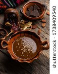 Small photo of Traditional mexican mole sauce on wooden background