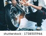Small photo of Bike repair. Young man repairing motobike in garage.mechanic fixing motocycle engine.Serious young man repairing his motorcycle in bike repair shop.