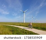 Woman On Electric Bicycle With...
