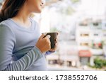 Woman Enjoy Her Coffee At The...