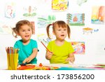 two little cute girls painting... | Shutterstock . vector #173856200