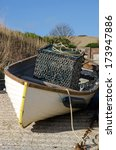Small Fishing Boat Moored On A...
