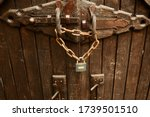 Old Wooden Gate With Lock And...