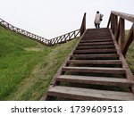 A Wooden Staircase Leads To Th...