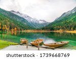 Small photo of Boats on a mountain lake. Great view of the mountains. Pleasure boats. Silence, appeasement. Jagersee lake in the Alps, Austria, near Wagrain