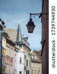 Closeup of vintage street lamp on historical architecture on the main place in Mulhouse - France