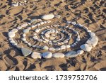 A Spiral Of Stones Is Laid Out...