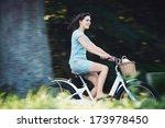 Carefree Woman Riding Bicycle...