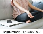 Small photo of body of woman exercise by pose yoga meditation with turn off computer and mobile phone, self care calm activity at home, social stop or disconnect digital detox concept.