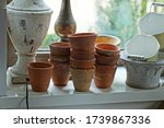 A Row Of Brown Clay Pots And...