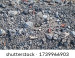 A wide view of a Killdeer nest showing how difficult it is to see the nest and eggs among the surrounding scattered stones.