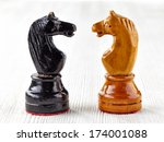 Two Old Wooden Chess Pieces On...