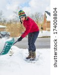 Woman Snow Shoveling Driveway