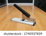 Side view of big stapler on the ...