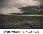 Rural Foggy and Cloudy Norwegian Raw Landscape. Scenic Alpine Road in South Western Part of Norway. - stock photo