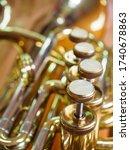 Small photo of close-up shot of piston value tuba, brass instrument piston value