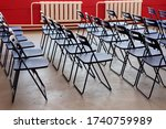Empty Plastic Chairs In Row...