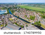 Aerial photo of the village of Knottingley in Wakefield in the UK, showing the village town centre along side the Leeds and Liverpool canal and bridge on a bright sunny summers day