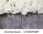 Stock photo white roses on wooden background selective focus copy space 174089489